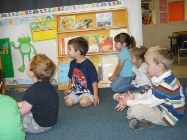 peaceful children listening to a picture book story,www.positiveparentalparticipation.com
