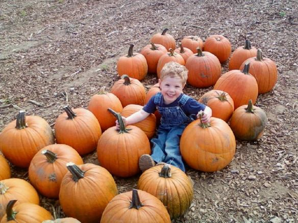 jeremy sitting with pumpkins 9_11