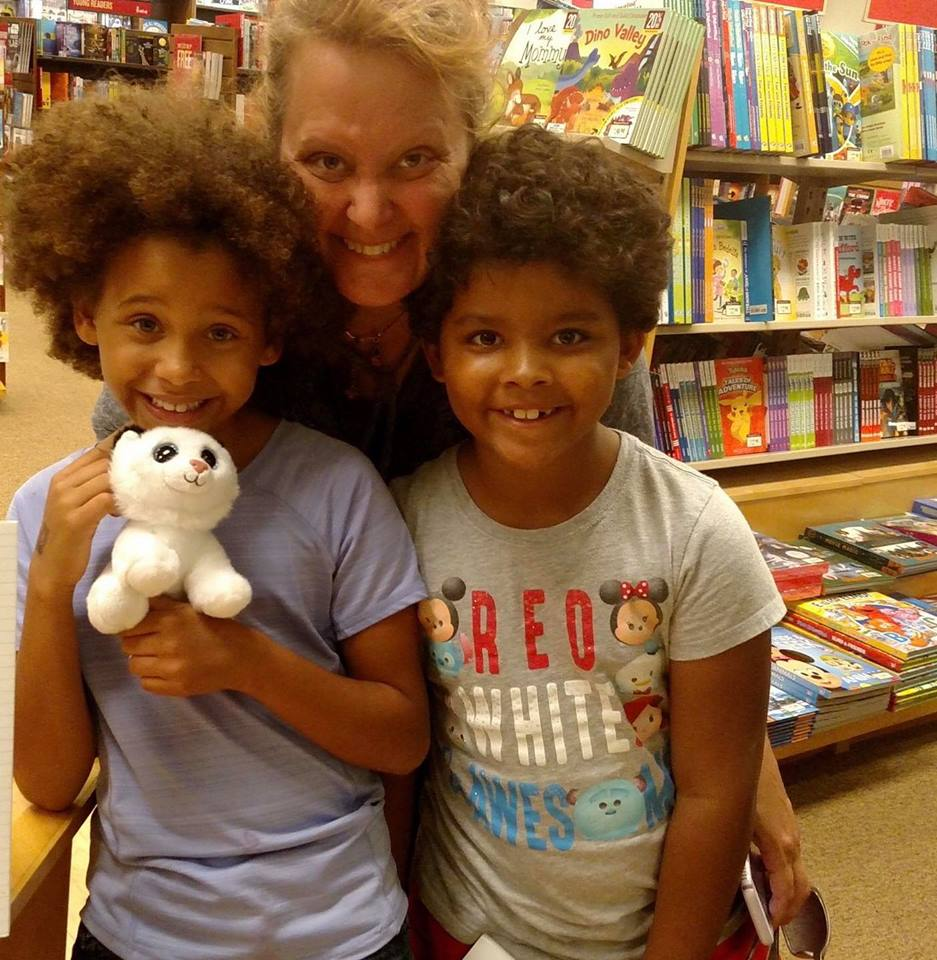with kids at bookstore or library