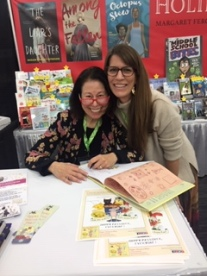 Signing a copy of PIppa's Passover Plate to Lindsay Leslie at the Holiday House booth at the NCTE conference