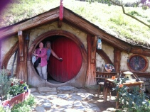 Diane and Vivian, peeking out from one of the Hobbit's cottages