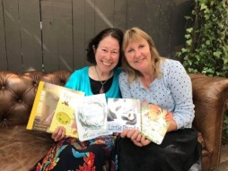 Happy debut authors with their books